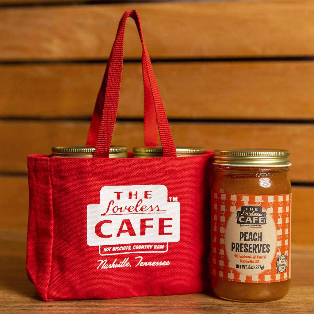 mini red tote with two jars of preserves
