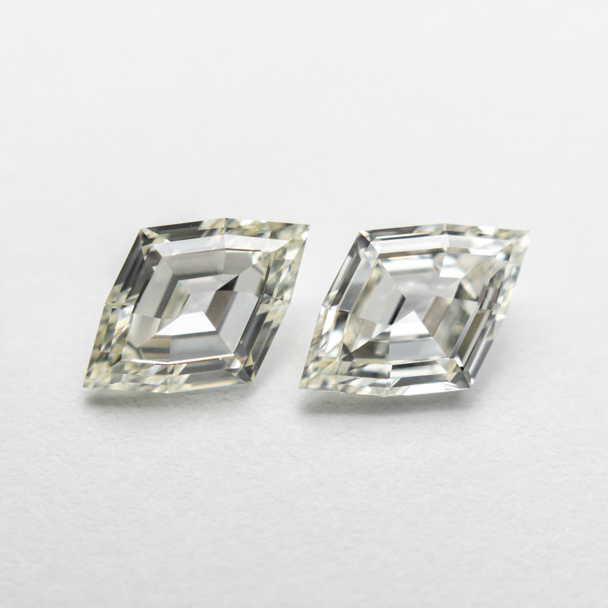 1.41ct 8.49x5.71x2.56mm VS/SI O-P Lozenge Step Cut Matching Pair 18877-01