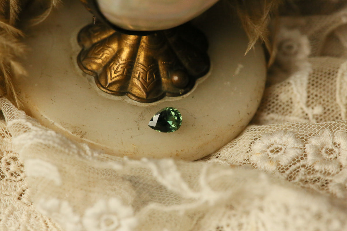 1.64 carat Forest Green Pear Sapphire