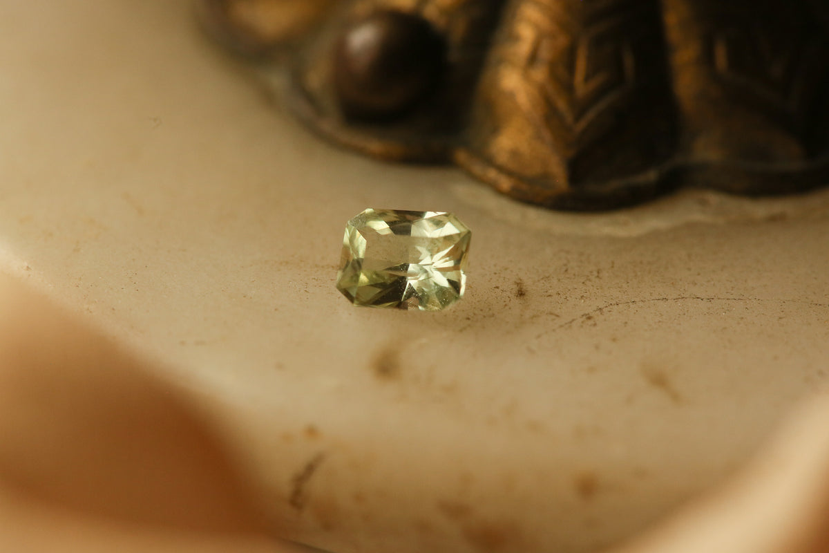 0.8 carat Pale Yellow Green Modified Emerald Cut Sapphire
