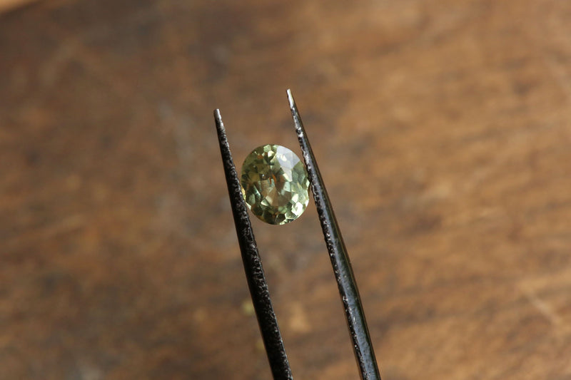 1.32 carats Oval Cut Pale Apple Green Sapphire