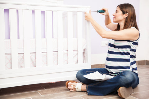 Pregnant Woman Building Crib