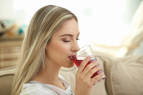 woman drinking juice