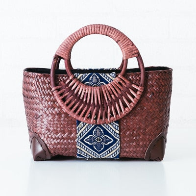 Thai version of the straw bag women's handbag retro fashion hand rattan grass package travel beach bag