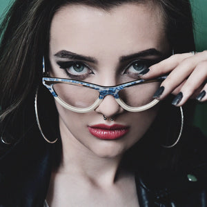 Female model wearing JOIUSS women's designer glasses frames
