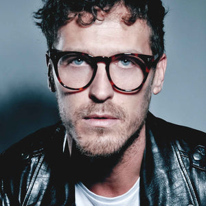 Male model wearing JOIUSS designer mens glasses frames