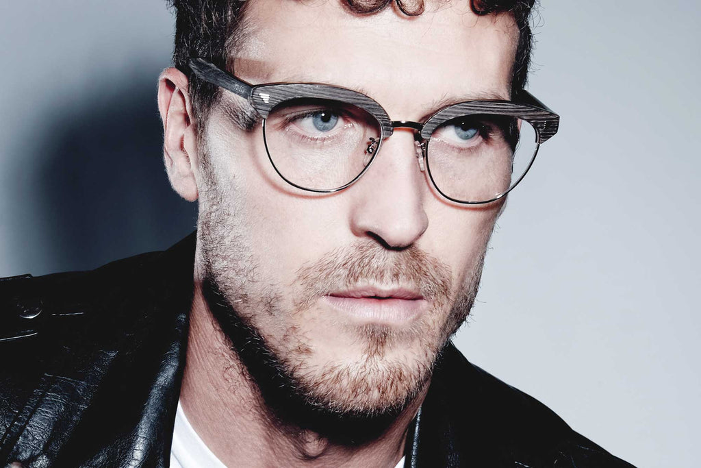Male model wearing the JOIUSS Malcolm dark grey wook effect glasses frame