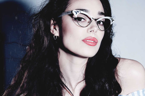 Female model wearing women's white glasses frames