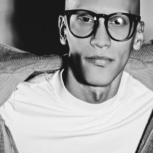 male model wearing black large round glasses