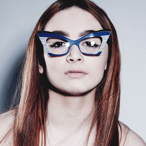 female model wearing navy & white cat eye glasses