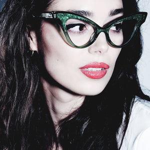 female model wearing clear green winged cat eye glasses