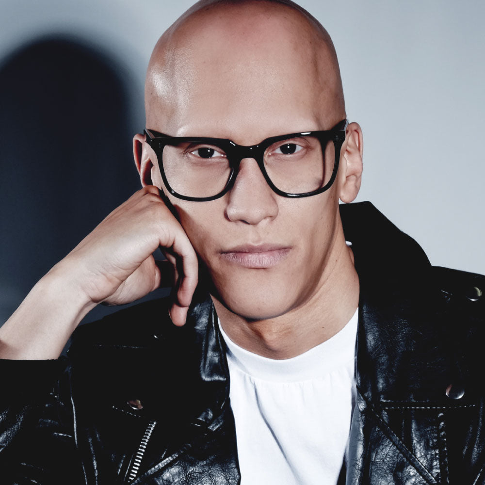 male model wearing black wayfarer glasses