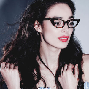 female model wearing tortoiseshell winged cat eye glasses