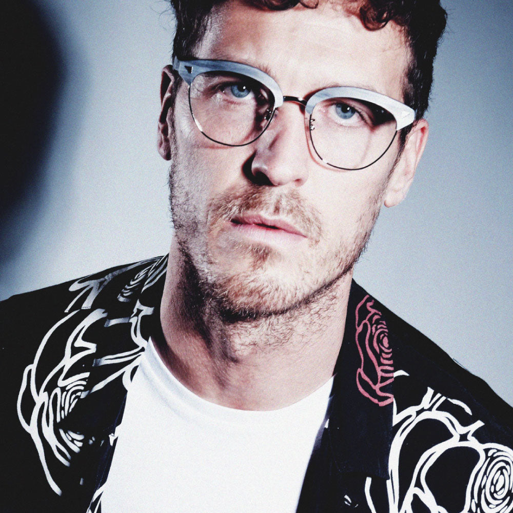 male model wearing light grey clubmaster glasses