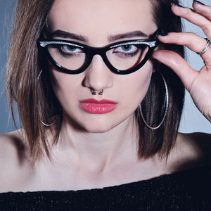 female model wearing black cat eye glasses