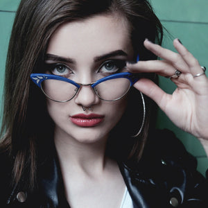 female model wearing blue & gold cat eye glasses