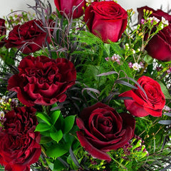 Link to one dozen imported red roses from Green Fresh Florals + Plants