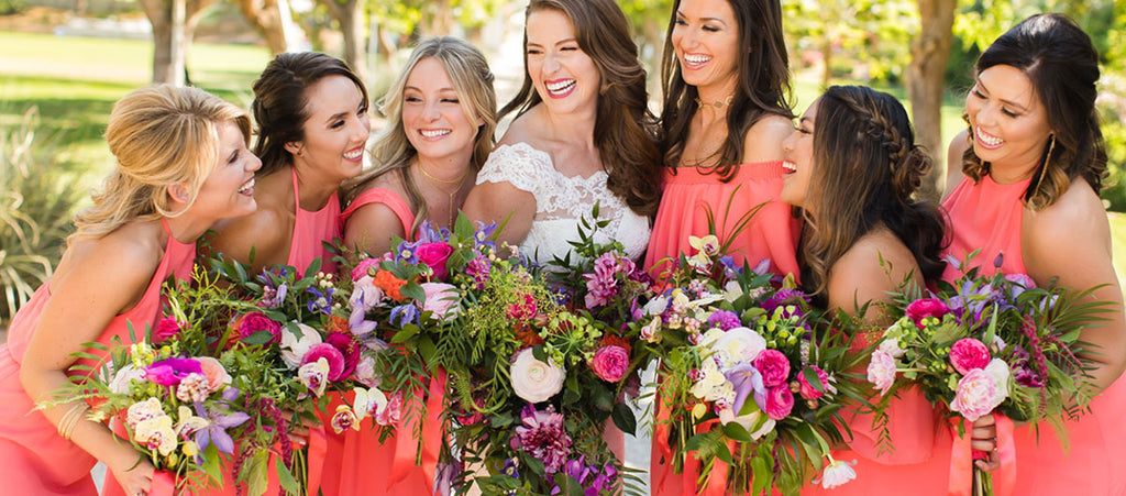 Floral Artistry Wedding and Event flowers picture of a bride and bridesmades with florals