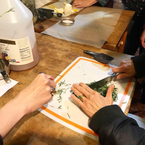 Chopping fresh herbs to make a skincare product