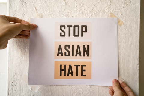 photo against wall stop asian hate