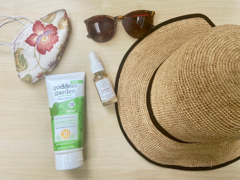 Summer essentials face mask sunscreen hat sunglasses facial mist