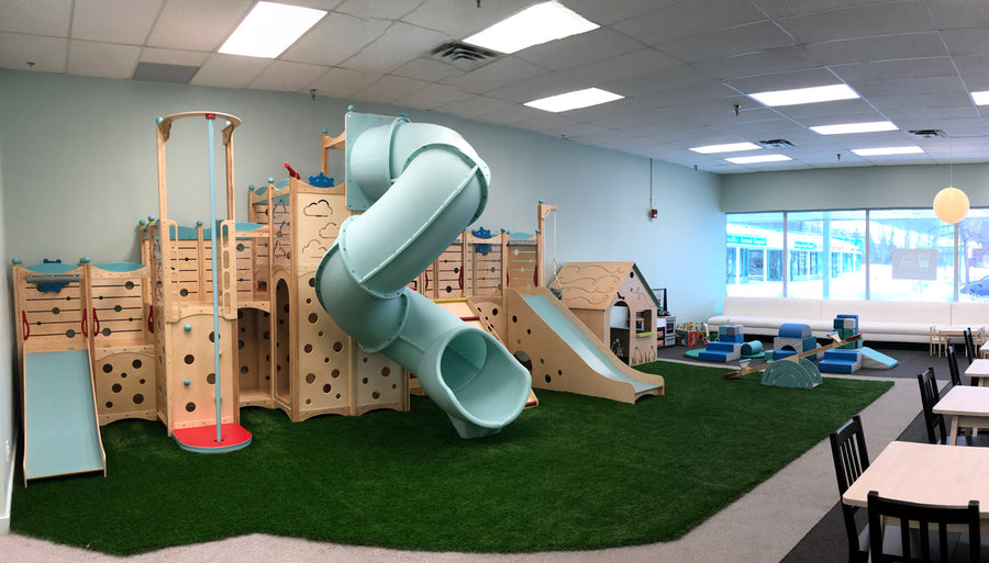 Indoor playground at Play A Latte Cafe with grass