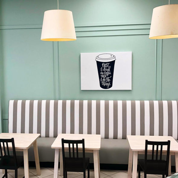 Cafe seating in front of blue wall with custom coffee artwork