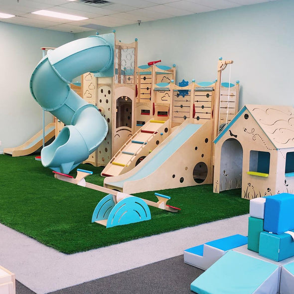 Indoor playground with slides and ladders for children to play