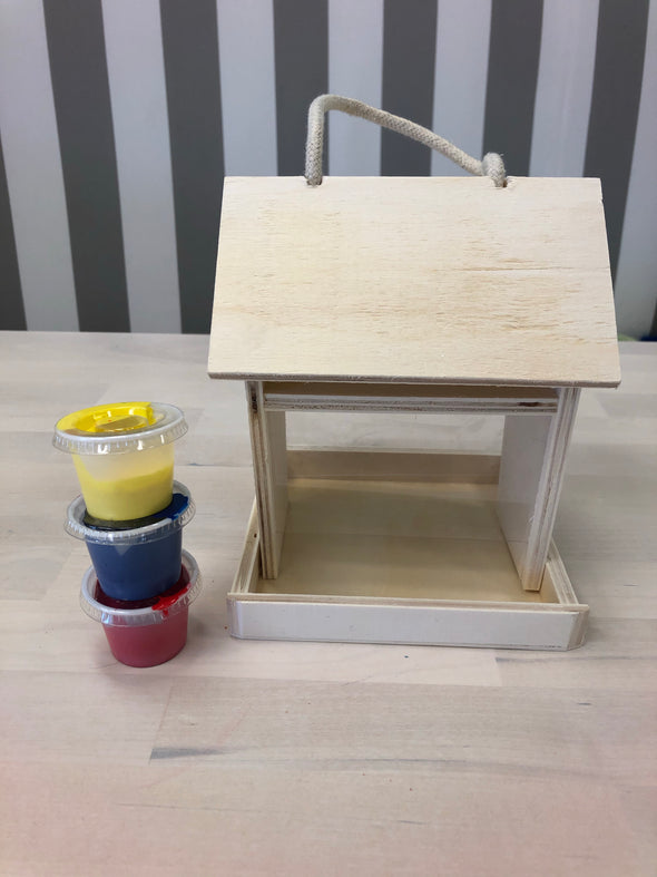 Birdhouse with paint and brush