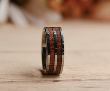 A mens wooden ring with tungsten inlay from Urban Designer.