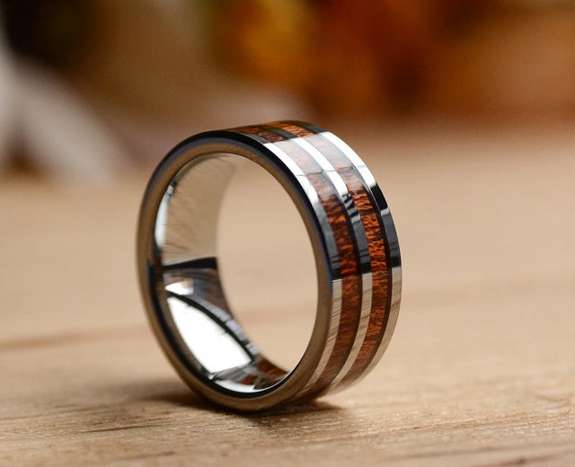 A tungsten wood wedding band from Urban Designer.