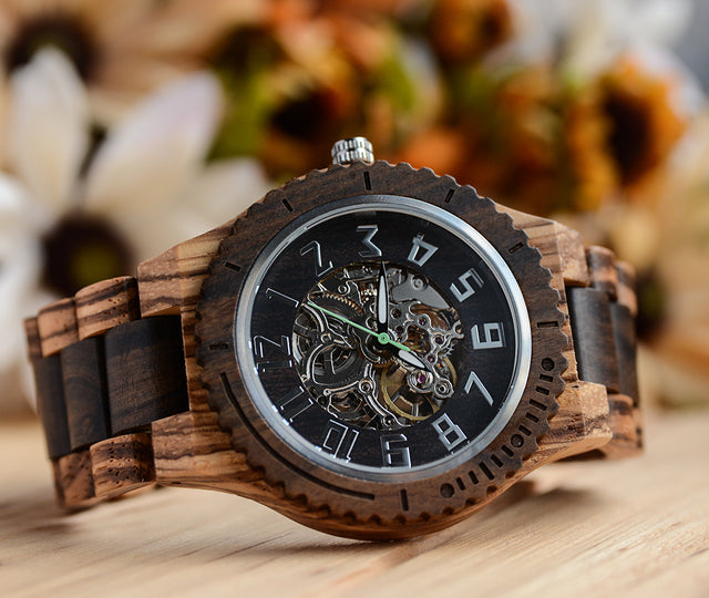 A mechanical wooden watch made by hand by Urban Designer.