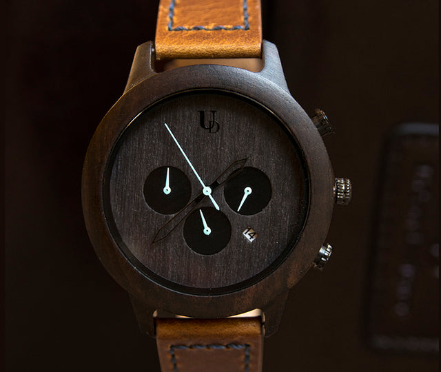 A beautiful dark face wooden wrist watch with leather band from Urban Designer.