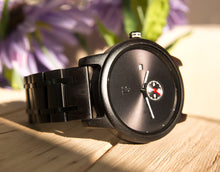 An elegantly minimalist dark wooden watch from Urban Designer.