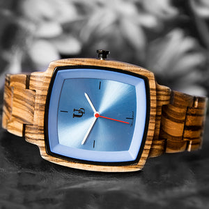 A wooden watch for sale featuring a sapphire face and Swiss Movement from Urban Designer.