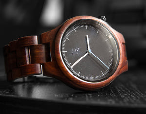 Classy wooden watch with black face from Urban Designer.