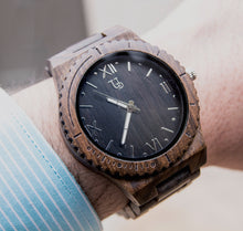 A dark watch made of wood with Japanese Movement from Urban Designer.