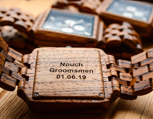 An engraved groomsmen wooden watch made with zebra wood from Urban Designer.