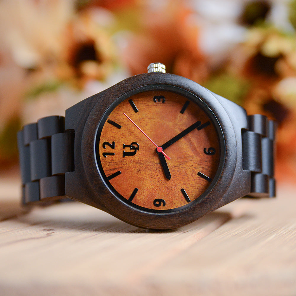 An unique dark wooden watch with orange face from Urban Designer.