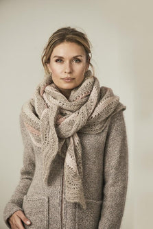 Alberte knitted shawl with stripes in beige and rose colors, made in Isager Spinni wool and Silk mohair, wrapped around the neck