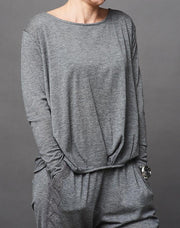 Anna cozy top, grey top with long sleeves and pleats in front, made in thin and light wool and cashmere, the front