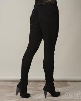 Anna black sweatpants with lace along the legs, made in thin and light wool and cashmere, the back