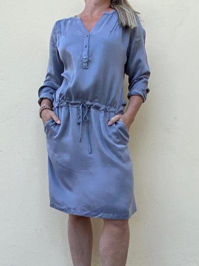 Belina zink grey short dress with long sleeves, pintucks and cord around the waist, made in cupro, the front