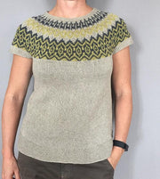 Björk/Bjørk icelandic inspired summer top in light beige with pattern in blue and yellow, made in Isager bomulin, closeup of front