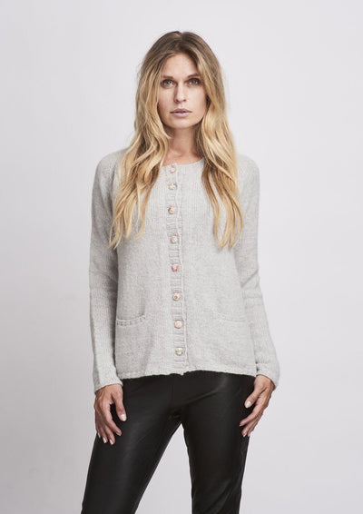 Classic knitted light grey cardigan with liberty buttons and pockets, made in Önling no 1 merino wool, the front