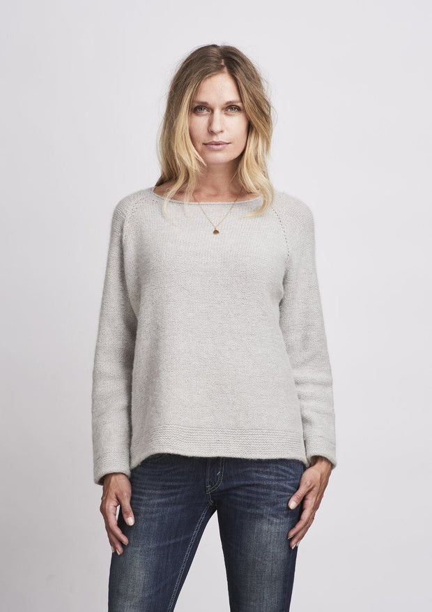 Caroline classic raglan sweater in light grey, made in Önling no 1 merino wool, the back
