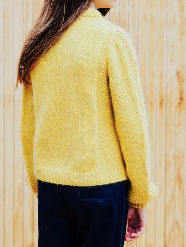 Knitting pattern for Copenhagen Sweater designed by June Thomsen for Yarn Lovers, featuring moss stitch