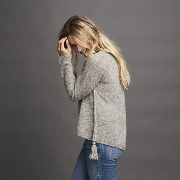 Dagmar classic, knitted grey sweater with braids at the sides, made in Isager alpaca and spinni wool, the side