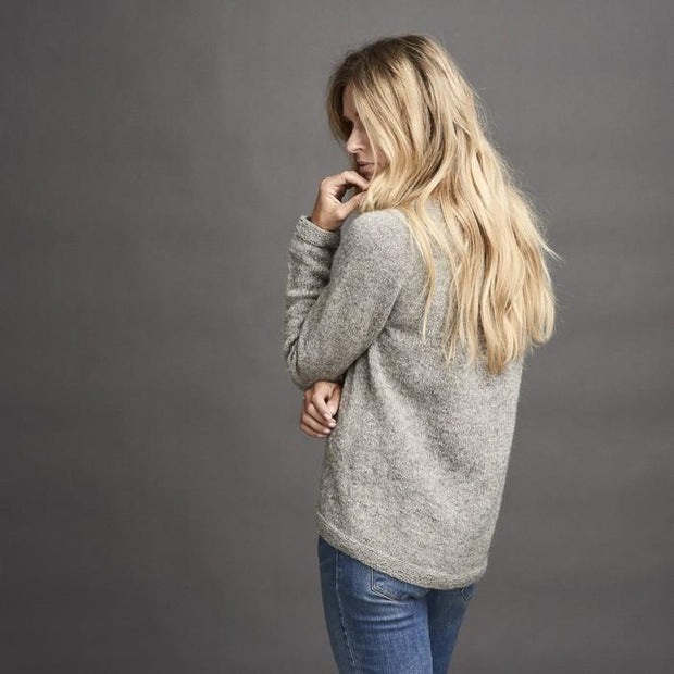 Dagmar classic, knitted grey sweater with braids at the sides, made in Isager alpaca and spinni wool, the back