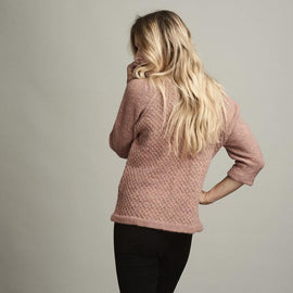 Dicte light knitted peach colored sweater with an elegant single color pattern, made in Isager Alapaca and Spinni wool, the back